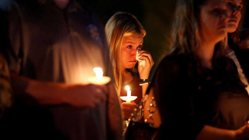 A woman wipes away tears during a memorial service for Charleston Hartfield, an off-duty Las Vegas police officer who was killed during the Route 91 music festival mass shooting, in Las Vegas, Nevada, Oct. 5, 2017.