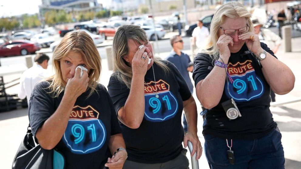 From left, Linda Hazelwood, Michelle Hamel and Jann Blake, all from California, cry as they attend a prayer service on the anniversary of the Oct. 1, 2017 mass shooting, Oct. 1, 2018, in Las Vegas.