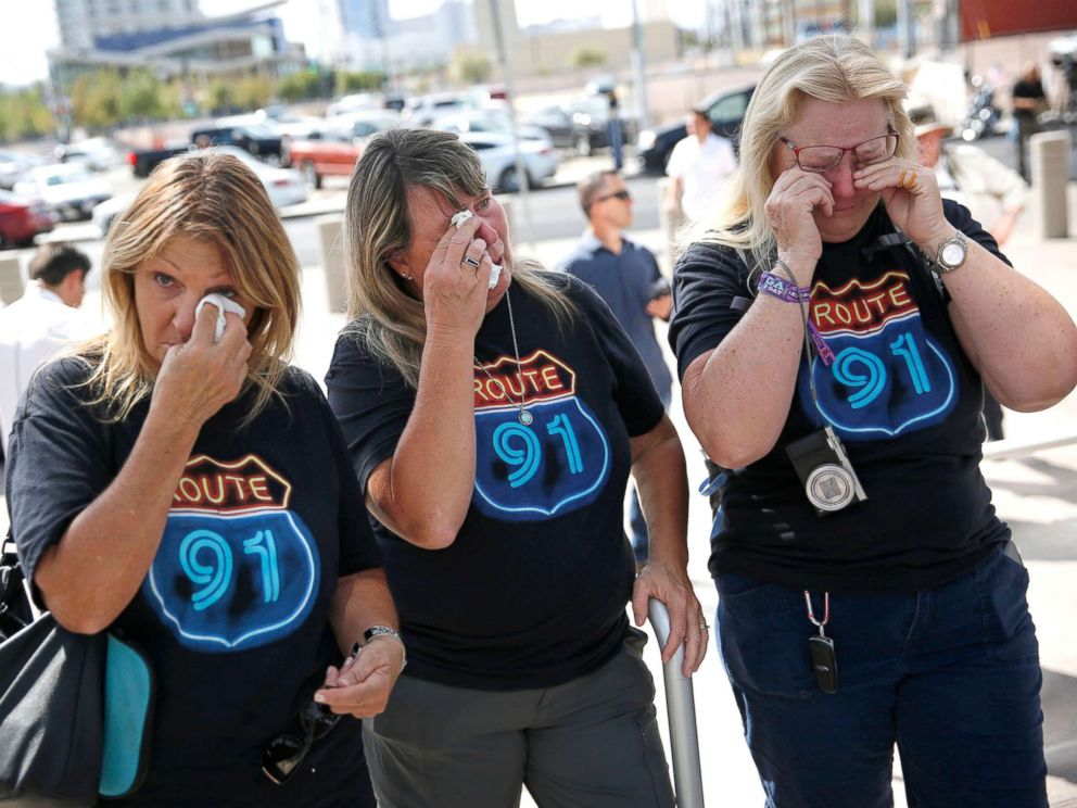 PHOTO: From left, Linda Hazelwood, Michelle Hamel and Jann Blake, all from California, cry as they attend a prayer service on the anniversary of the Oct. 1, 2017 mass shooting, Oct. 1, 2018, in Las Vegas.