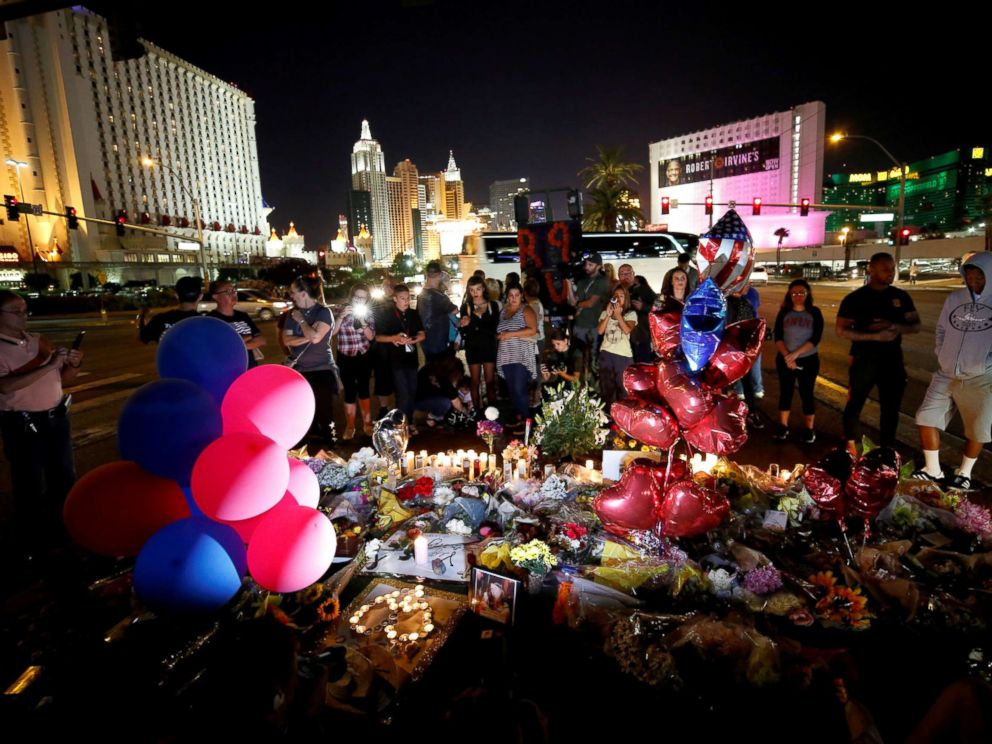 PHOTO: People gather at a makeshift memorial in the middle of Las Vegas Boulevard following the mass shooting in Las Vegas, Oct. 4, 2017.