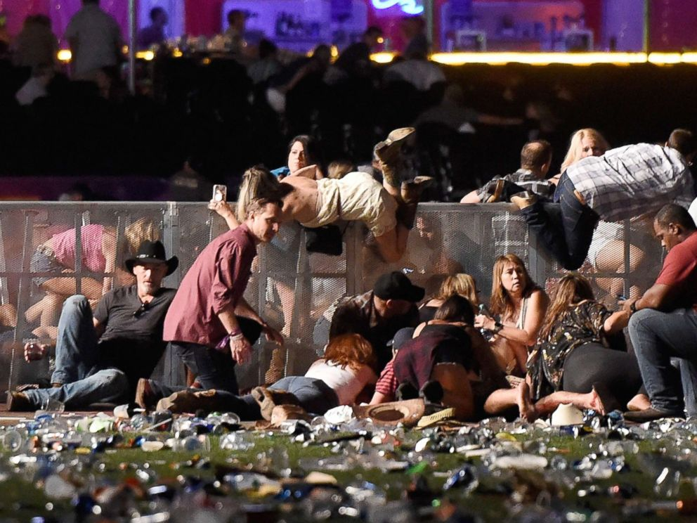 PHOTO: People scramble for shelter at the Route 91 Harvest country music festival, Oct. 1, 2017, in Las Vegas.