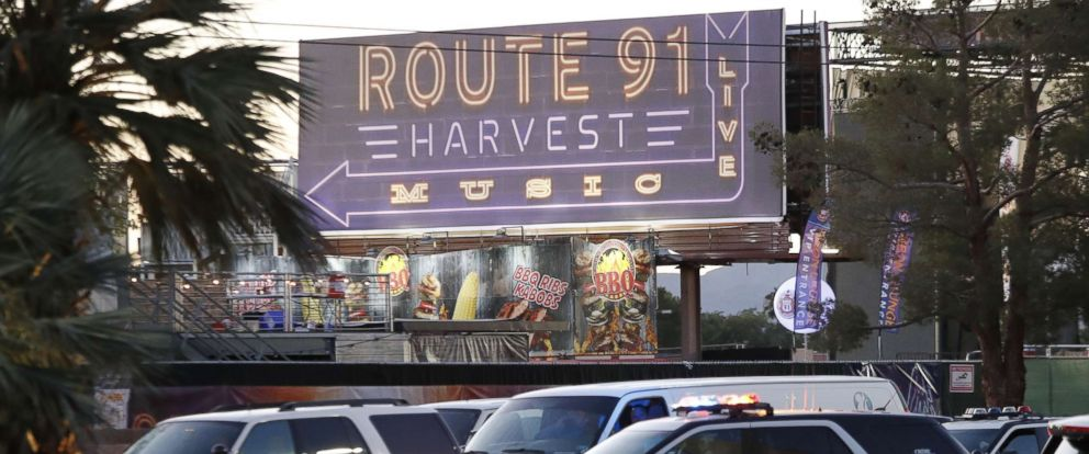 PHOTO: Las Vegas Metropolitan Police in front of a sign for the Route 91 Harvest festival near the scene of the mass shooting at the Route 91 Harvest festival on Las Vegas Boulevard in Las Vegas, Oct. 2, 2017.