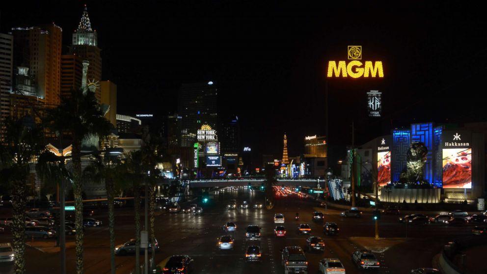 Las Vegas lights dim in tribute to shooting victims, heroes