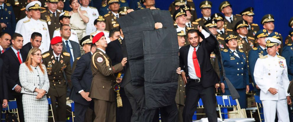 PHOTO: In this photo released by Chinas Xinhua News Agency, security personnel surround Venezuelas President Nicolas Maduro during an incident as he was giving a speech in Caracas, Venezuela, Aug. 4, 2018.