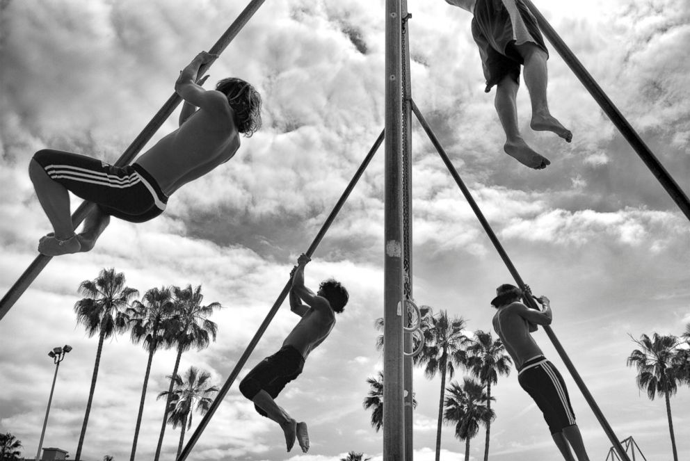 PHOTO: Challenge Monday - Venice Dynamics is a group of calisthenics enthusiasts who meet regularly in the sand pit by Muscle Beach to exer-cise together.  Venice Beach: The last days of a bohemian paradise? venice beach 11 ht mem 180801 hpEmbed 3x2 992