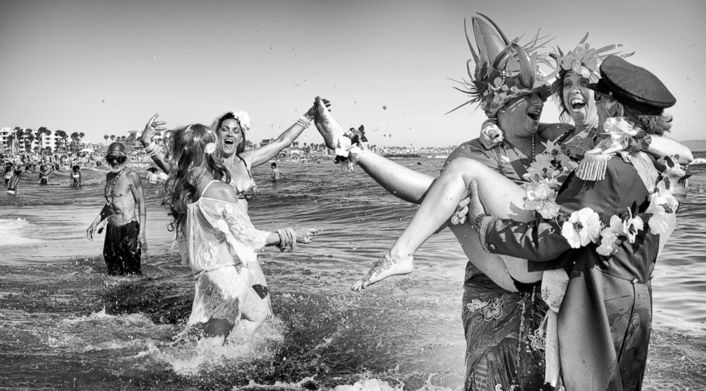 PHOTO: Neptune Parade - King and Queen Neptune frolic in the Pacific Ocean waters, celebrating the start of summer with the yearly Neptune Parade.  Venice Beach: The last days of a bohemian paradise? venice beach 32 ht mem 180801 hpEmbed 9x5 992