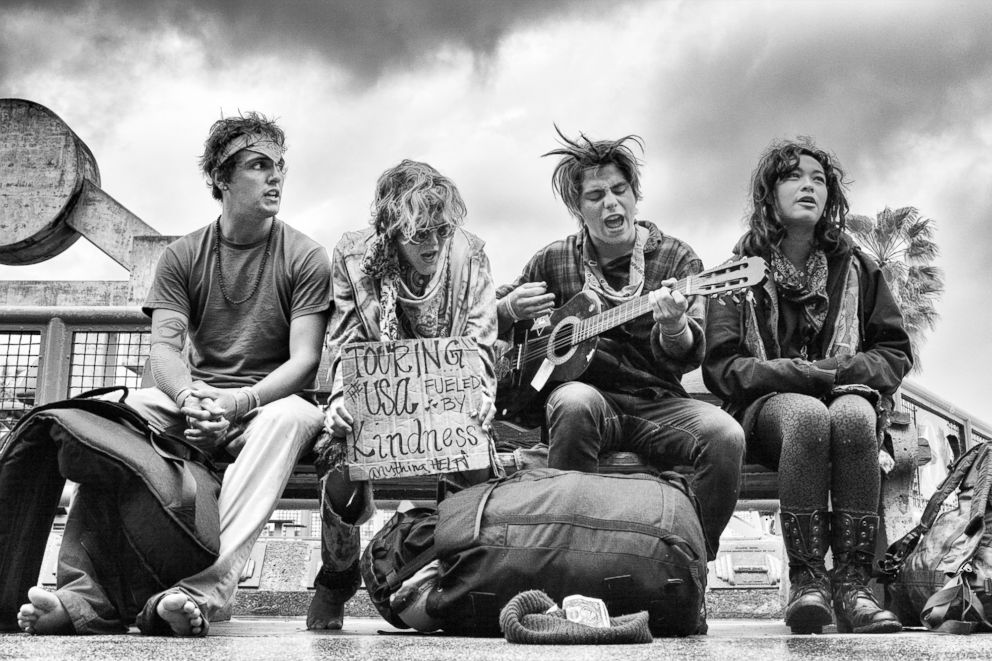 PHOTO: Singing in the Rain - A group of young hippies sing on a bench across from the Muscle Beach Gym.  Venice Beach: The last days of a bohemian paradise? venice beach 35 ht mem 180801 hpEmbed 3x2 992