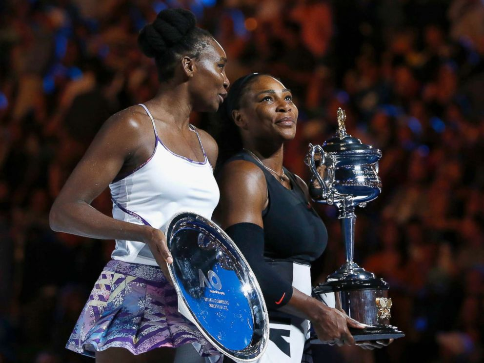 PHOTO: Serena Williams holds her trophy after winning her women's singles final against Venus Williams in Melbourne, Australia, on January 28, 2017.