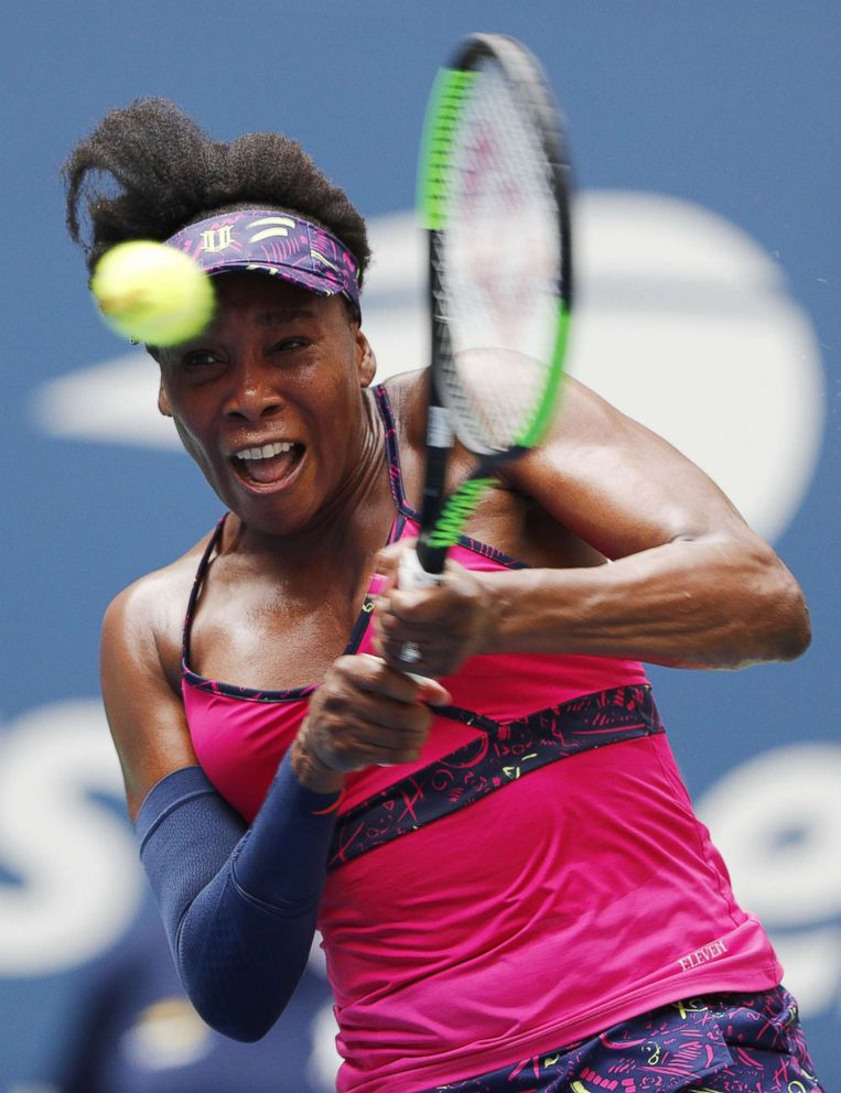 PHOTO: Venus Williams strikes a return to Russia's Svetlana Kuznetsova in the Arthur Ashe Stadium on the first day of the US Open Tennis Championships in New York, August 27, 2018.