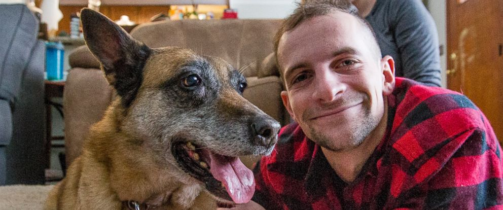 PHOTO: In this undated photo Joe Steenbeke poses for a photo with Tess at their home in Culver, Ind. The northern Indiana veteran was reunited with the bomb-sniffing dog he served with years ago in Afghanistan.