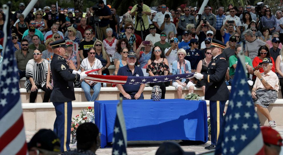 PHOTO: An honor guard folds an American flag during an open funeral service for U.S. Army veteran Edward K. Pearson, Oct. 1, 2019, at the Sarasota National Cemetary in Sarasota, Fla.
