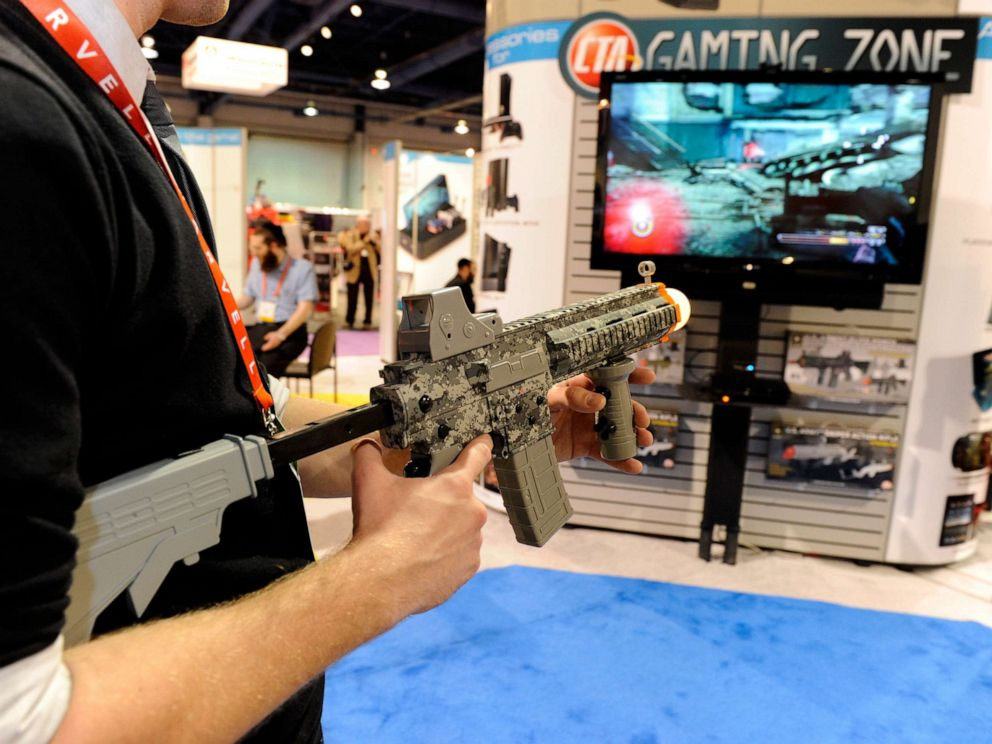 PHOTO: A player uses a U.S. Army Elite Force Assault Rifle Controller to play a video game at the CTA Digital booth at the 2012 International Consumer Electronics Show, January 12, 2012, in Las Vegas.