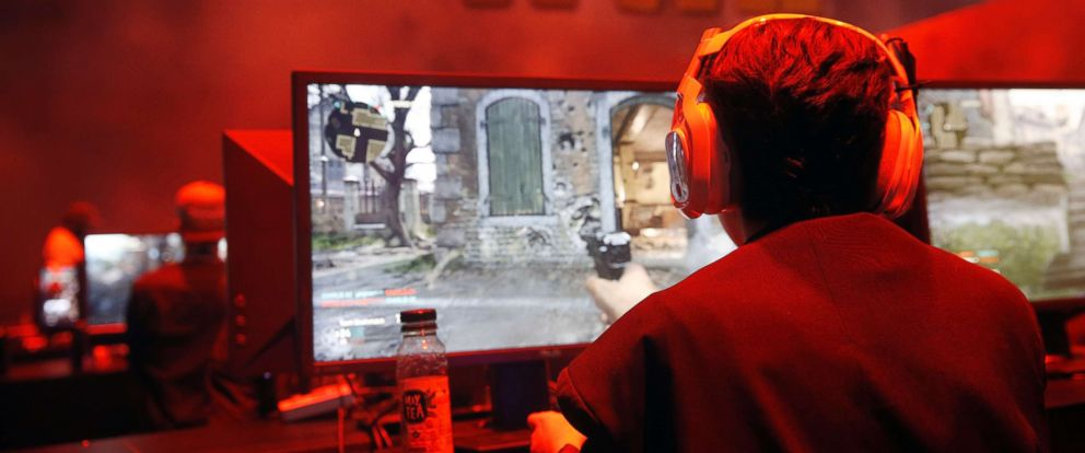 "PHOTO: Gamers play the video game ""Call of Duty WWII"" developed by Sledgehammer Games and published by Activision during the Paris Games Week, Oct. 31, 2017, in Paris."