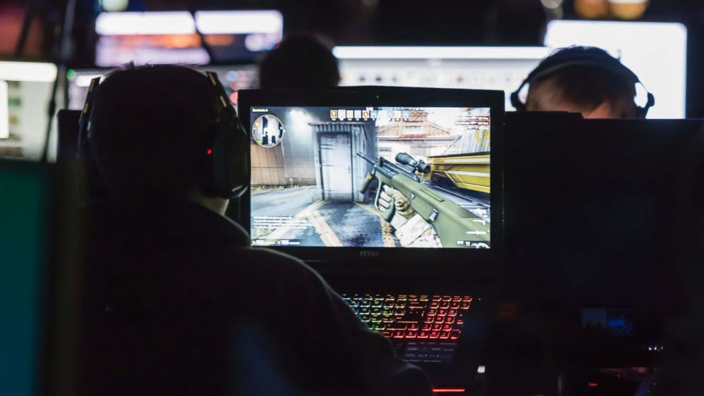 """Computer gamers play the first person shooter """"Counterstrike CS:GO"""" during a tournament, Dec. 10, 2015 at NetGame 2015, Switzerland's largest computer game convention in Thun, Switzerland."""