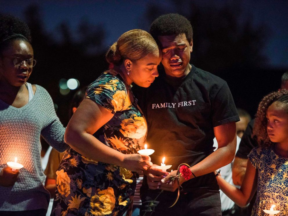 PHOTO: Veronica Hartfield (2L) widow of Las Vegas Metropolitan Police Department Officer Charleston Hartfield, and their family attend a vigil for Charleston Hartfield at Police Memorial Park, Oct. 5, 2017 in Las Vegas.