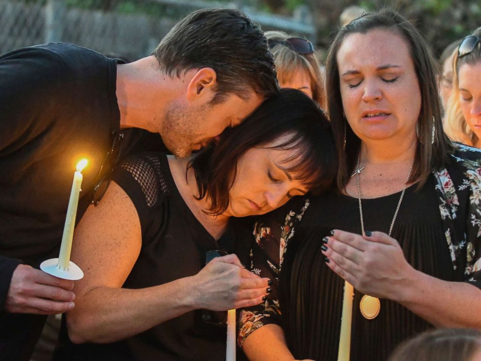 PHOTO: Ryan DiDonato, left, lays his head on Heather Gyurina, center, and Tracy Gyurina, right, during a candlelight vigil for their friend Teresa Nicol Kimura at Sierra Vista Elementary in Placentia, Calif., Oct. 8, 2017.