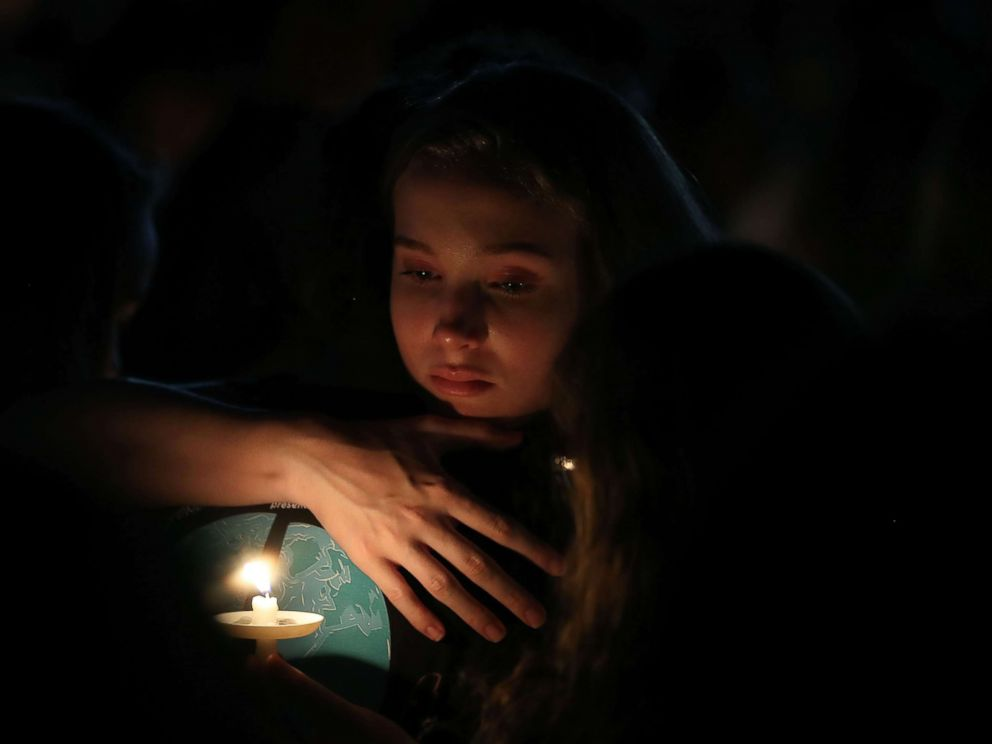 PHOTO: A young lady clutches a buddy at some level of candlelight vigil for victims of the mass shooting at Marjory Stoneman Douglas Excessive College the day outdated to this, at Pine Path Park, Feb. 15, 2018 in Parkland, Fla.