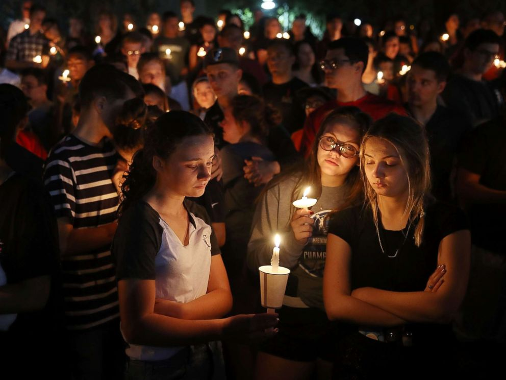 PHOTO: Folks serve a candle gentle memorial provider for the victims of the shooting at Marjory Stoneman Douglas Excessive College that killed 17 folks, Feb. 15, 2018 in Parkland, Fla.