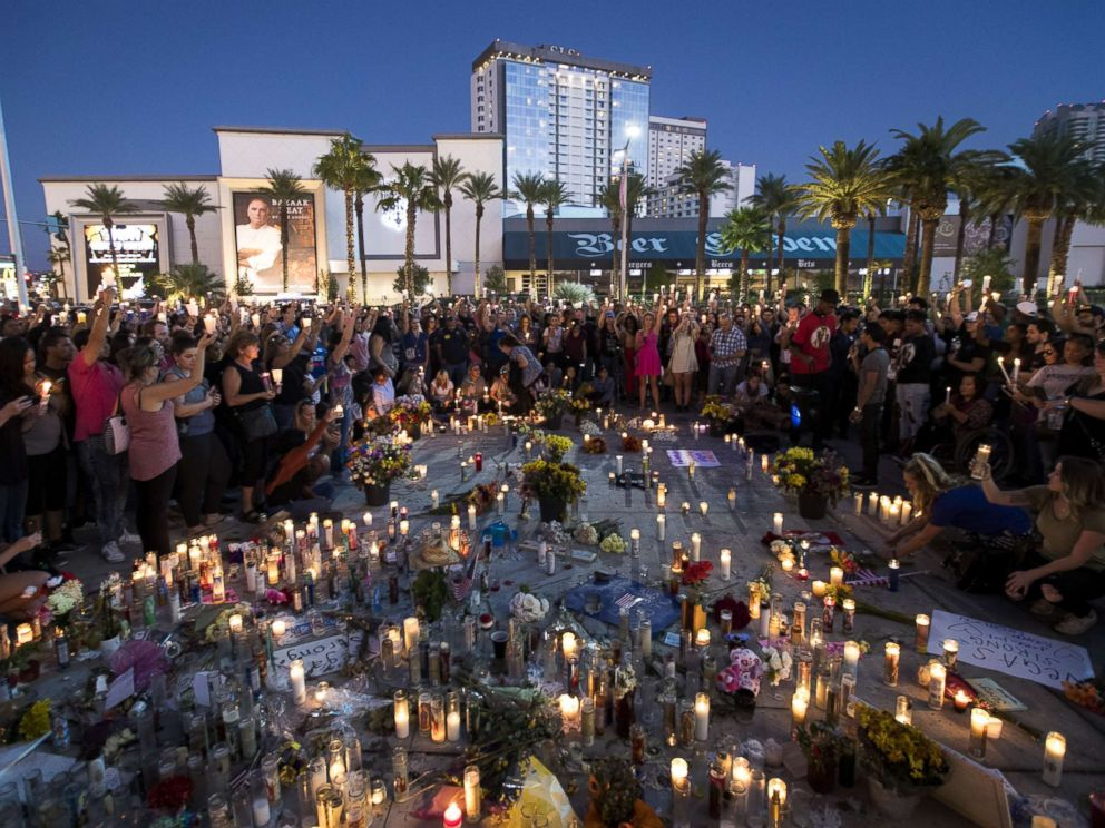 PHOTO: Mourners hold their candles in the air during a moment of silence during a vigil to mark one week since the mass shooting at the Route 91 Harvest country music festival, Oct. 8, 2017 in Las Vegas.