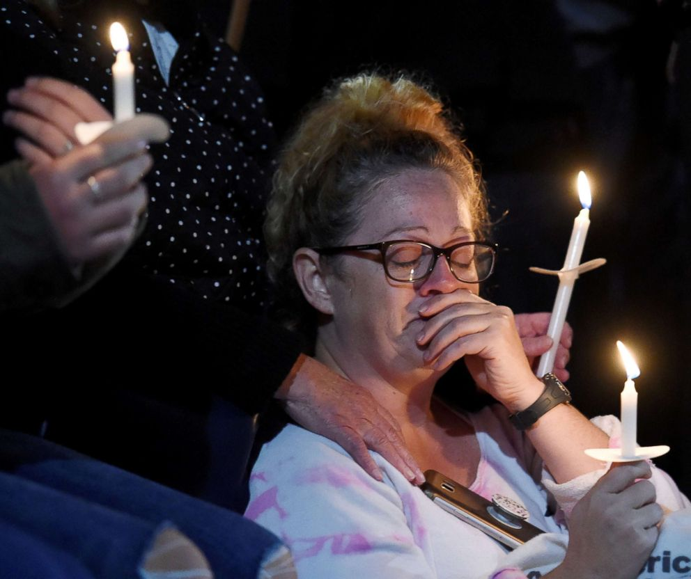 PHOTO: A family member, who asked not to be identified, mourns during a candlelight vigil for the victims of a limousine accident in upstate New York, in Amsterdam, N.Y., Oct. 8, 2018.