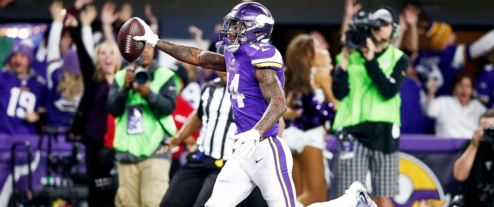 PHOTO: Stefon Diggs, No.14, of the Minnesota Vikings scores a touchdown as time expires against the New Orleans Saints during the second half of the NFC Divisional Playoff game on Jan. 14, 2018, in Minneapolis.