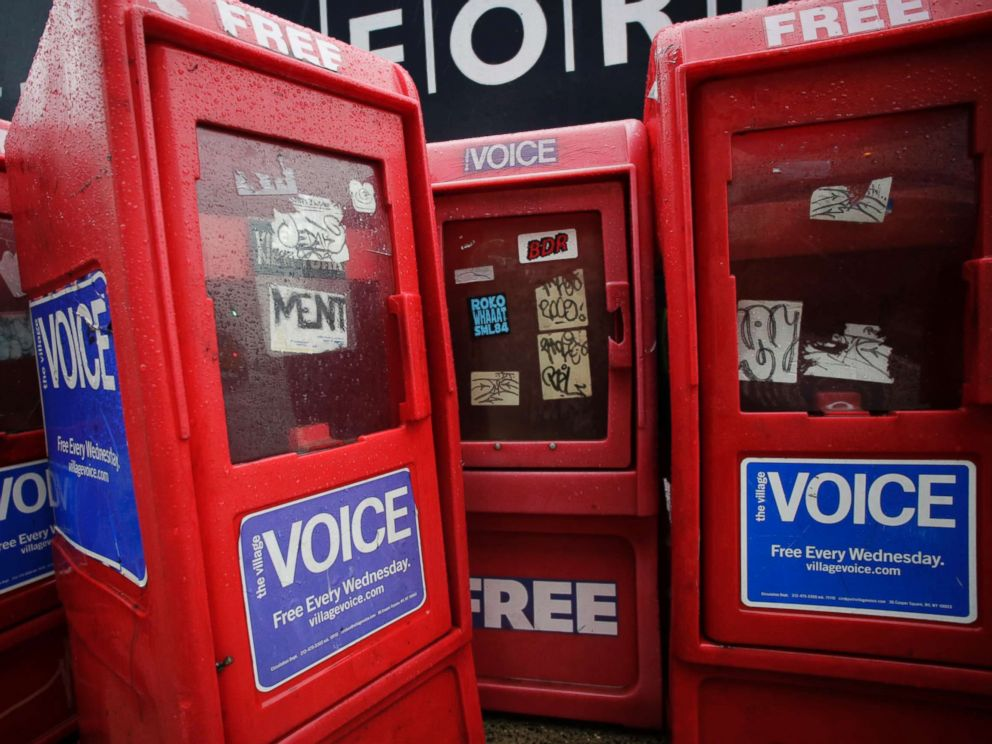 PHOTO: Plastic newspaper boxes for The Village Voice stand along a Manhattan sidewalk in New York on Nov. 27, 2013. Village Voice publisher Peter Barbey announced on Aug. 31, 2018, that the venerable alternative weekly will cease publication.