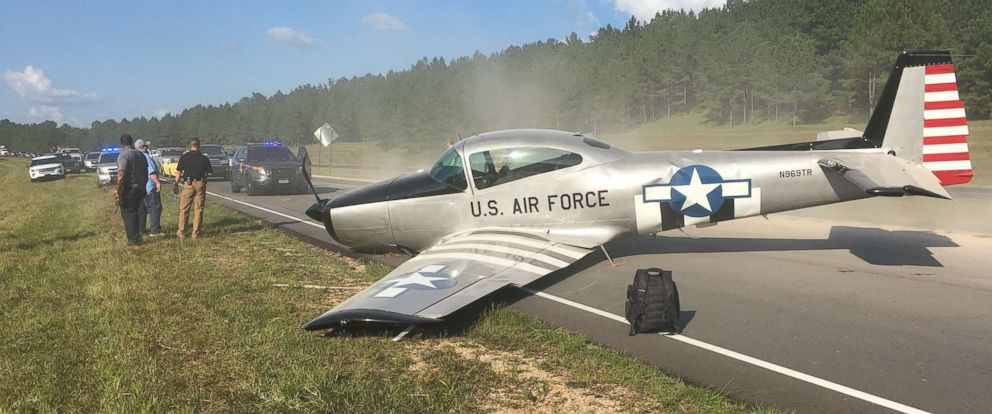 Vintage plane crash lands on highway in Mississippi