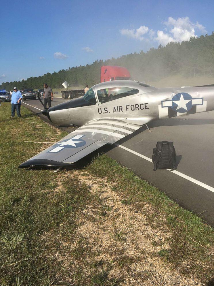 Vintage plane crash lands on highway in Mississippi