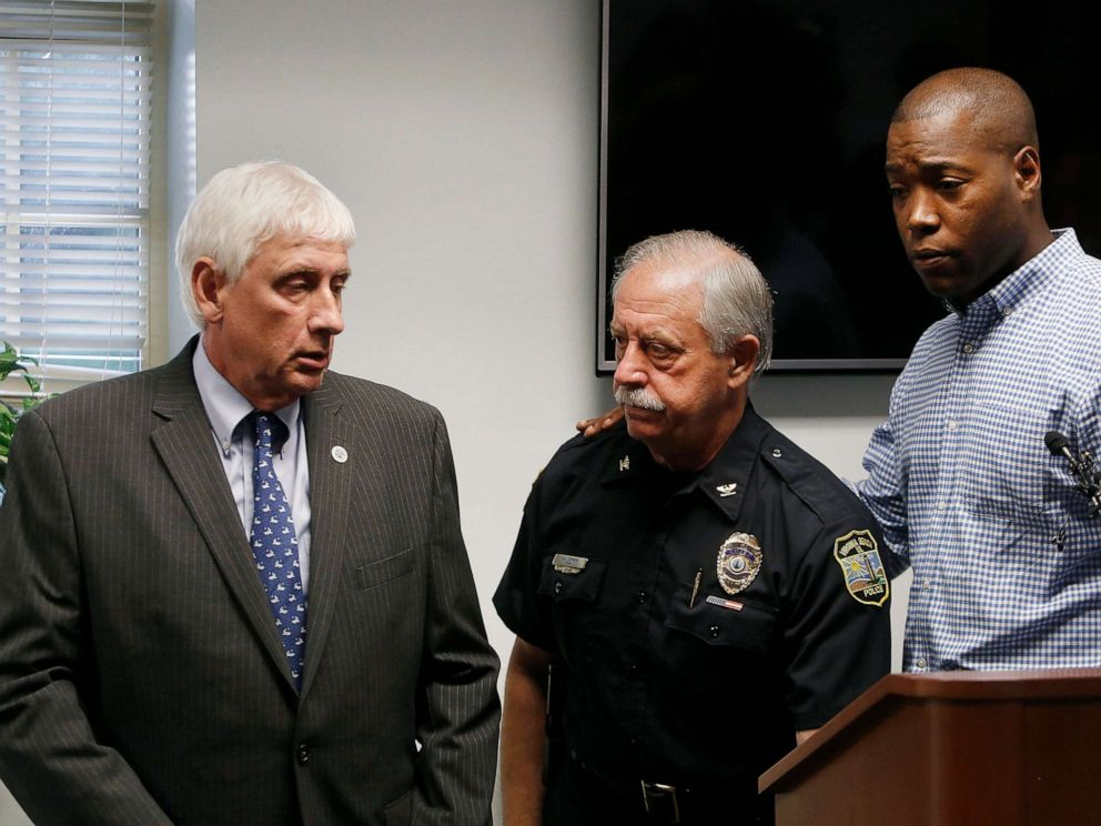 PHOTO: Virginia Beach Mayor Bobby Dyer, left, looks on as City Councilman Aaron Rouse, right, comforts Chief of Police James Cervera following a press conference, May 31, 2019 in Virginia Beach, Va.