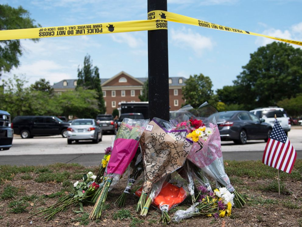 PHOTO: Flowers sit on the ground outside a municipal building where a gunman killed 12 in Virginia Beach, Va., June 1, 2019.