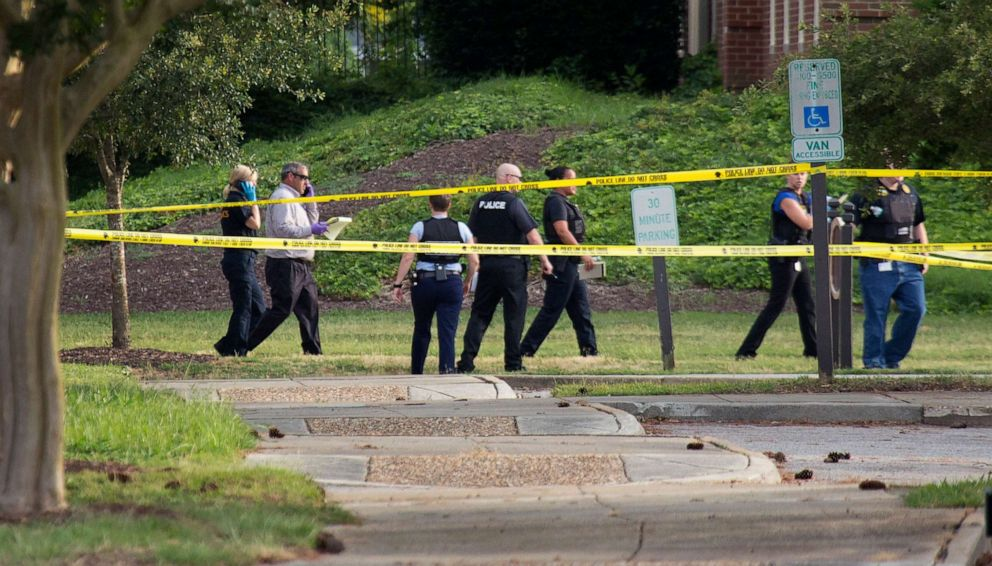 PHOTO: Police work the scene where eleven people were killed during a mass shooting at the Virginia Beach city public works building, May 31, 2019 in Virginia Beach, Va.