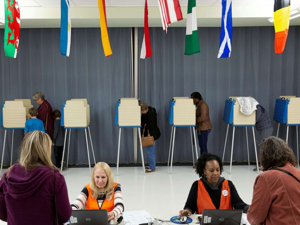 PHOTO: Voters cast their ballots to vote in state and local elections at Robious Middle School in Midlothian, a suburb of Richmond, Virginia, Nov. 5, 2019.