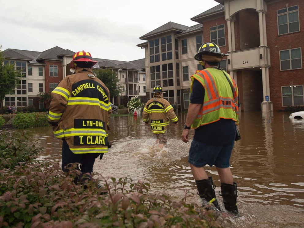 PHOTO: Members of the Campbell County Fire Department wade through water at an apartment complex in Lynchburg, Va., Aug. 2, 2018.