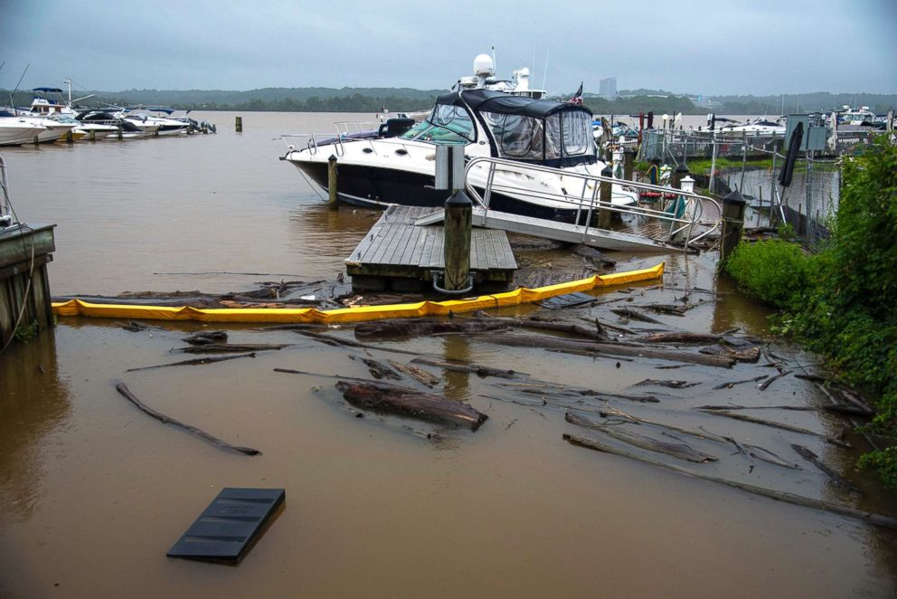 PHOTO: A dock at the City Marina in Alexandria, Va., floods after days of raining, July 24, 2018.