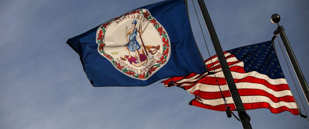 PHOTO: The Virginia state flag and the American flag fly near the Virginia State Capitol, Feb. 9, 2019, in Richmond, Va.