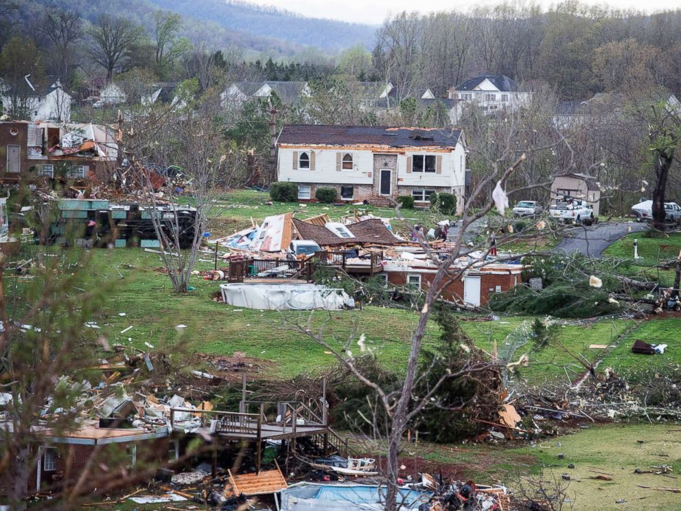 PHOTO: Debris surrounds storm-damaged homes, April 16, 2018, in Elon, Va.