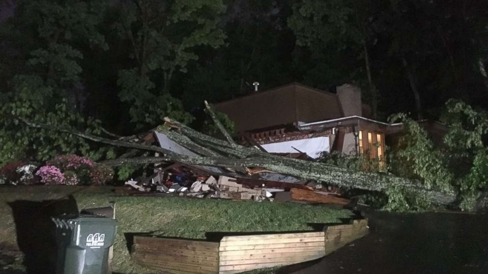 A tree crushed a home in Reston, Virginia, after severe storms hit the mid-Atlantic region on Monday, May 14, 2018.