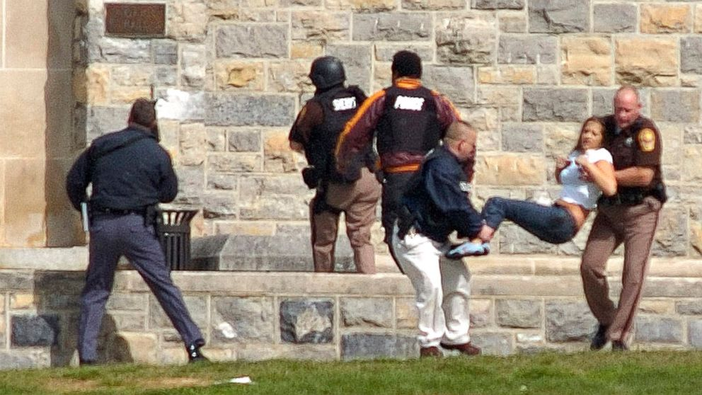 An injured person is carried out of Norris Hall at Virginia Tech in Blacksburg, Va., April 16, 2007. Seung-Hui Cho, a senior at the school, killed 32 people before taking his own life.