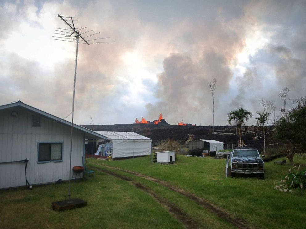 PHOTO: Lava from a fissure erupts on a residence in Leilani Estates, on Hawaiis Big Island, May 26, 2018 in Pahoa, Hawaii.