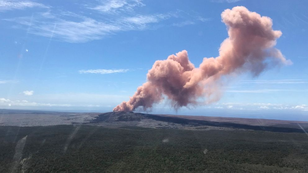 In this photo provided by the U.S. Geological Survey, red ash rises from the Kilauea Volcano on Thursday in Hawaii.
