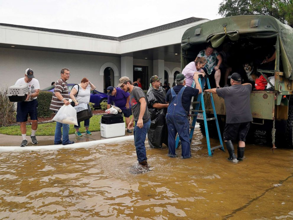PHOTO:Volunteers load people into a military truck to evacuate them from flood waters from Hurricane Harvey in Dickinson, Tex., Aug. 27, 2017.