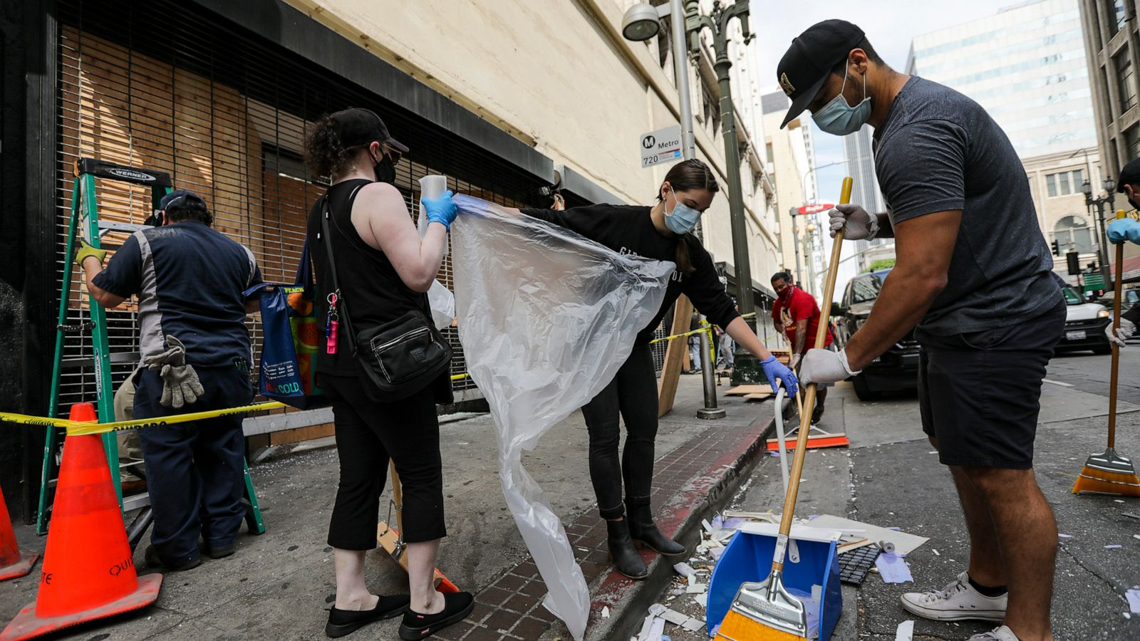 Volunteers across the US clean up glass, graffiti in wake of ...