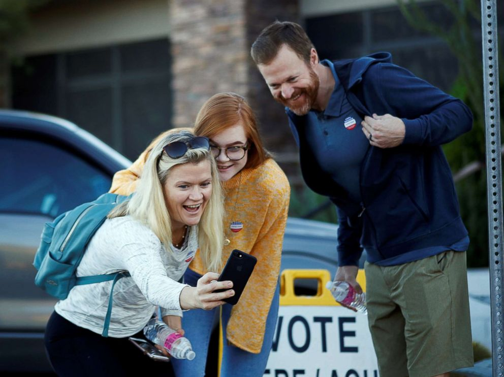 PHOTO: Victoria Leach, 18, takes a selfie with her parents Tricia Leach and Marc Leach after voting at a polling station in Carefree, Ariz., Nov. 6, 2018.