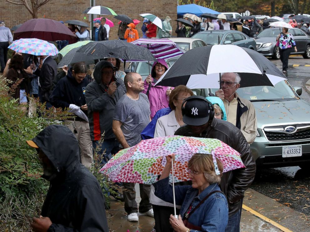 PHOTO: Virginia residents line up in the pouring rain to vote, Nov. 6, 2018 in Midlothian, Va.
