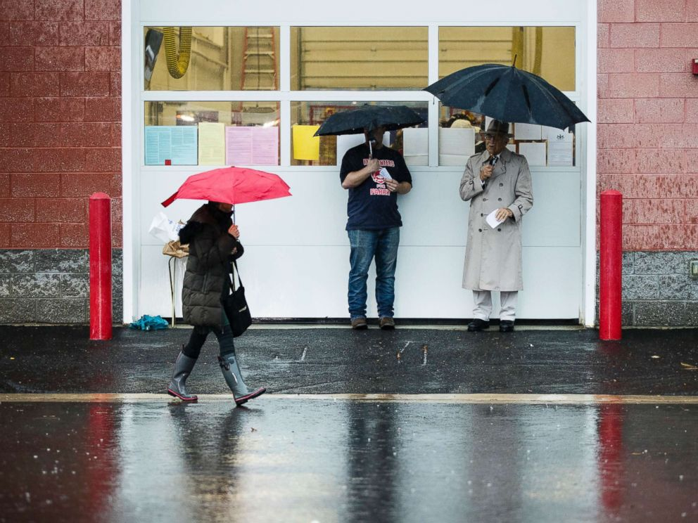 PHOTO: A voter walks in the rain from her polling place after voting in Langhorne, Pa., Nov. 6, 2018.