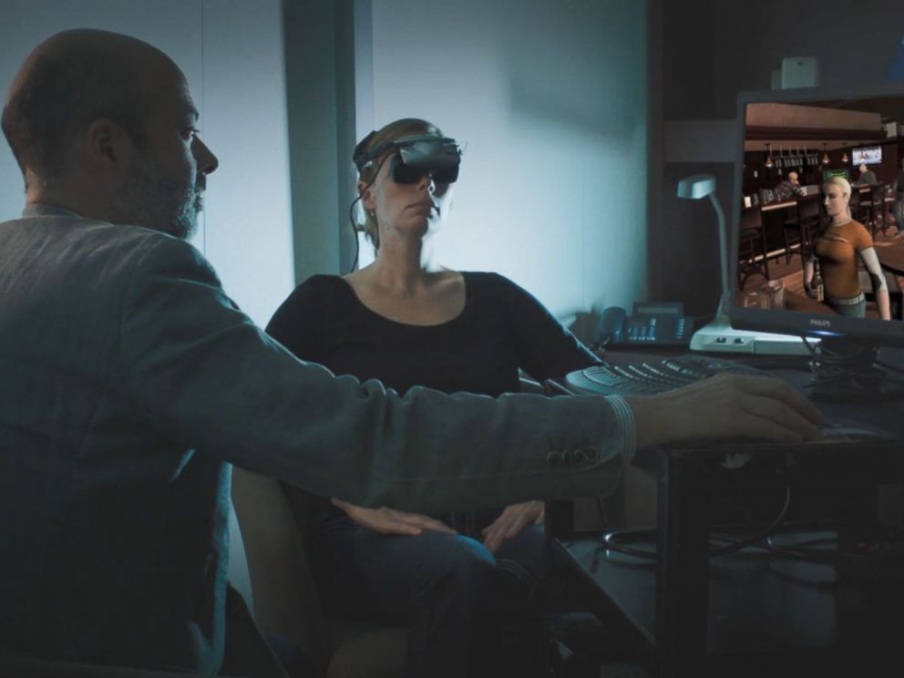 PHOTO: Dr. Stéphane Bouchard demonstrates a virtual reality therapy method that helps survivors of sexual assault face their fears