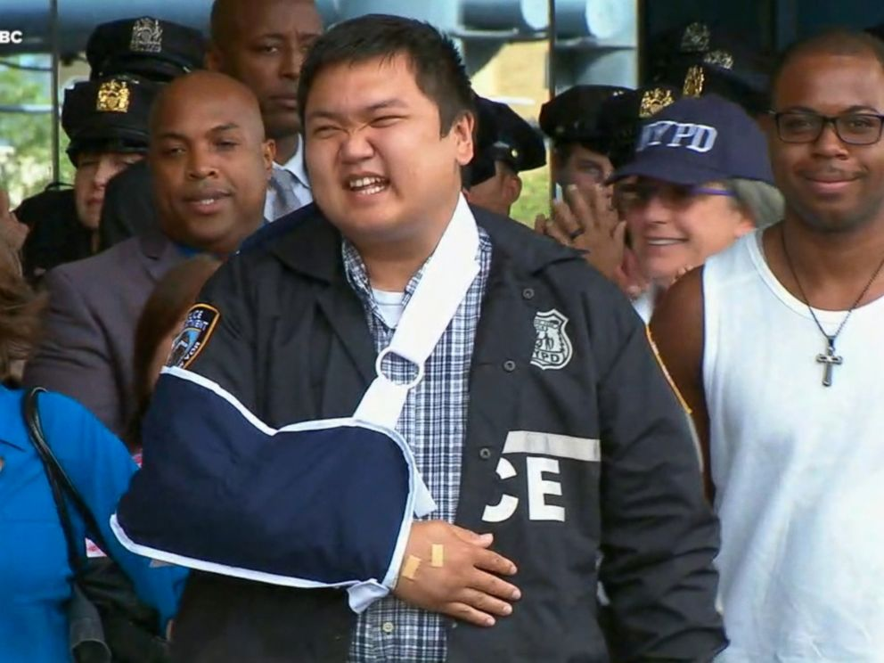 PHOTO: Officer Hart Nguyen smiles as he leaves the hospital, Aug. 11, 2017.