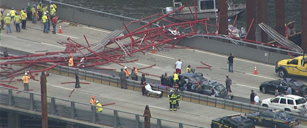 PHOTO: An image made from video shows a crane that collapsed across the Tappan Zee Bridge in New York, July 19, 2016.