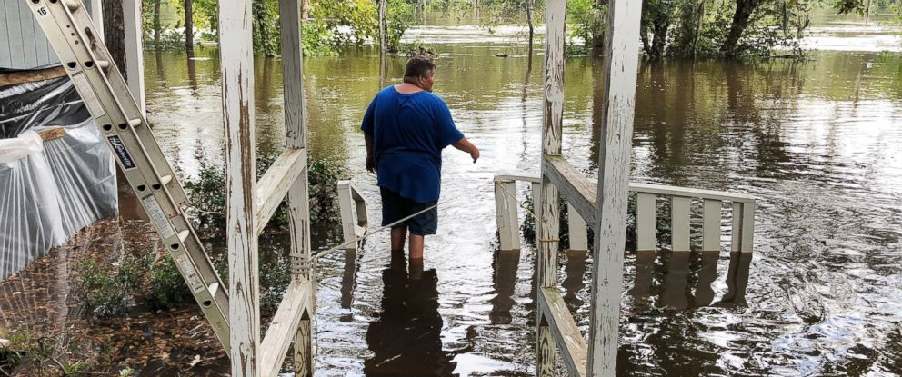 PHOTO: Shawn Lowrimore, Pastor Willie Lowrimore of The Fellowship With Jesus Ministries, son, wades into water near the church in Yauhannah, S.C., on Monday, Sept. 24, 2018.