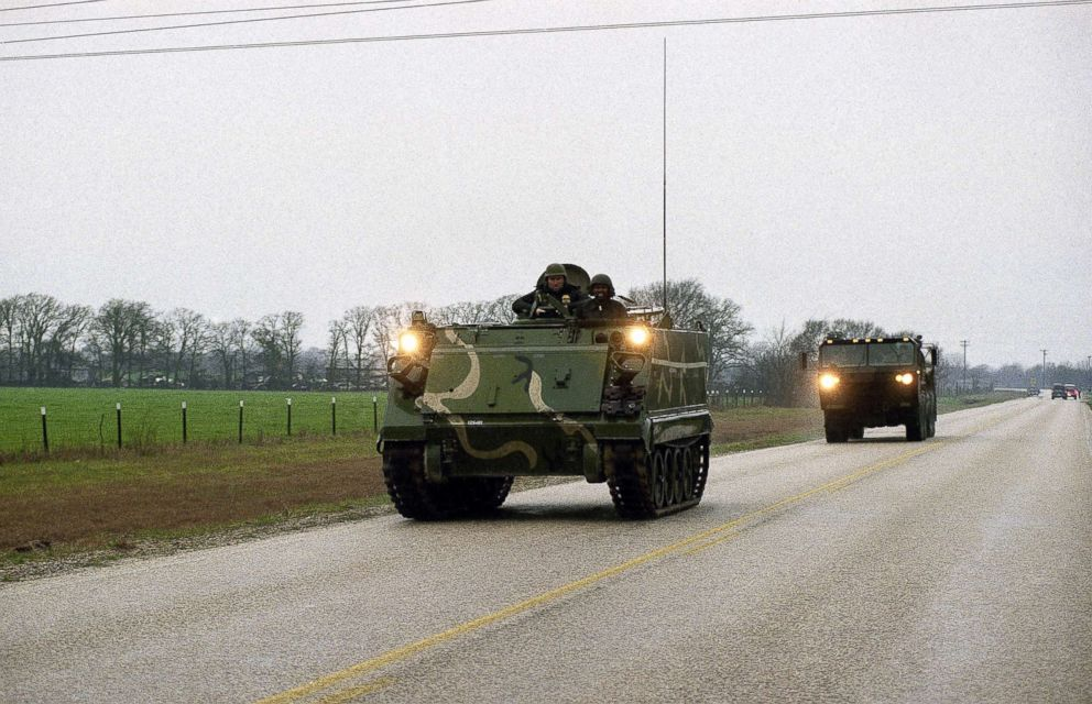 A Texas National Guard armored personnel carrier heads towards the Mount Carmel compound of the Branch Davidians cult near Waco, Texas, Feb. 28, 1993.